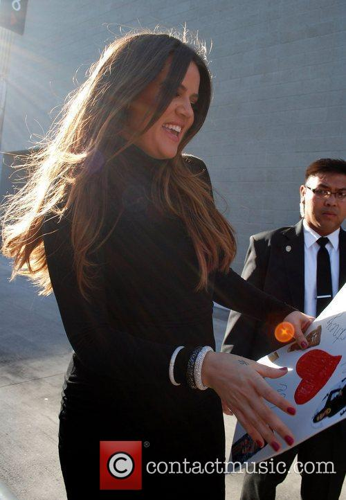 Meets fans as she arrives at the Jimmy...