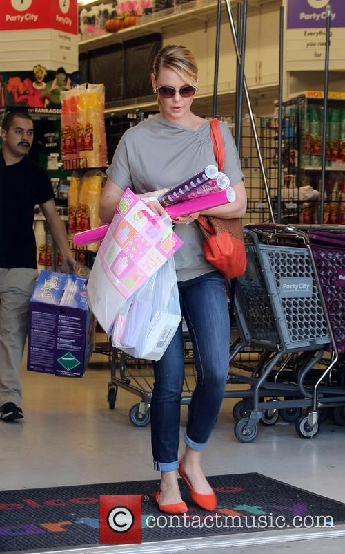 Katherine Heigl, her husband Josh Kelly and their...