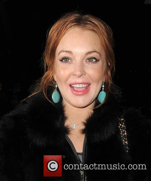 Lindsay Lohan arrives at Nozomi restaurant with her...