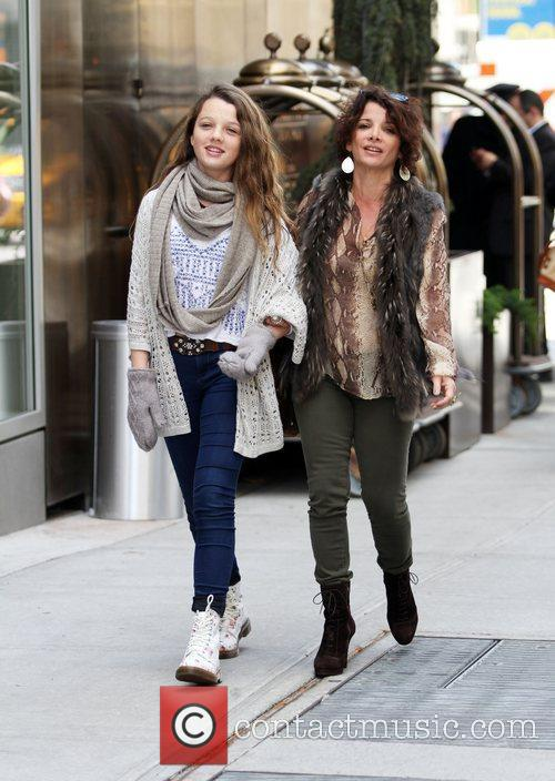 Actress Stephania Owen and her mother leaving their...