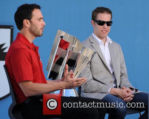 Brad Keselowski and Jimmie Johnson appear at a...
