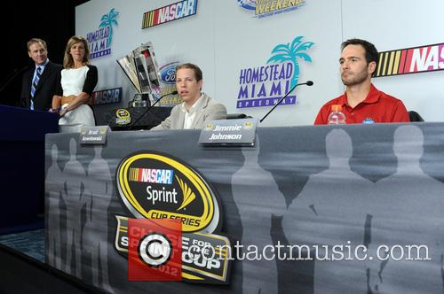 Brad Keselowski and Jimmie Johnson appear at a...