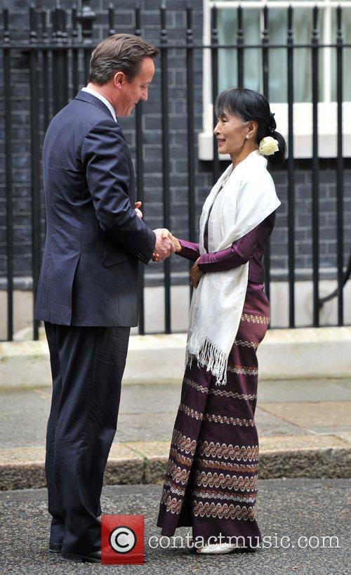 British Prime Minister David Cameron (L) meets Burmese...