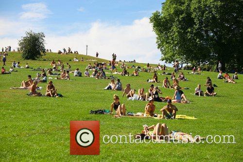 Sunbathers enjoying the last days of summer in...