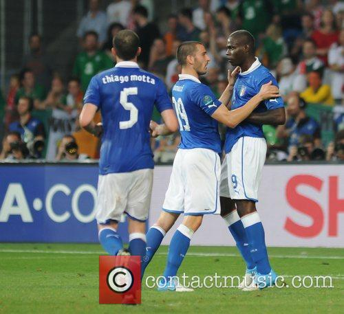 Mario Balotelli (Manchester City FC) scores for Italy...