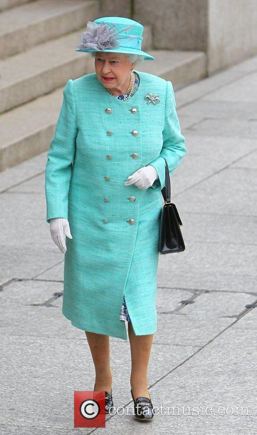 Queen Elizabeth II at a Market Square as...