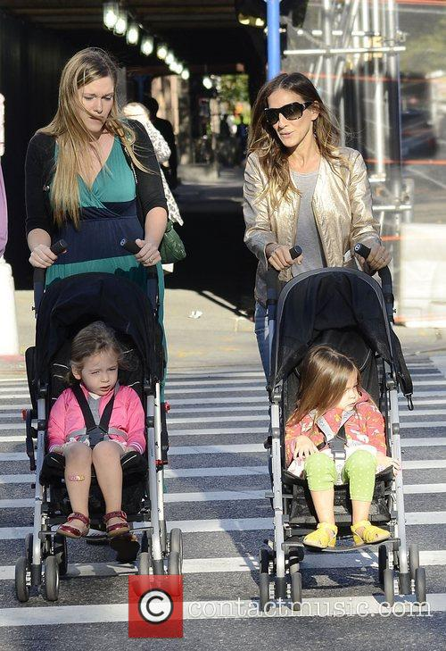 Sarah Jessica Parker walking her daughters Tabitha and...