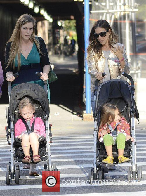 Walking her daughters Tabitha and Marion to school
