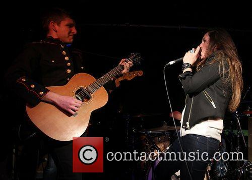Performing live in concert at the O2 Academy...