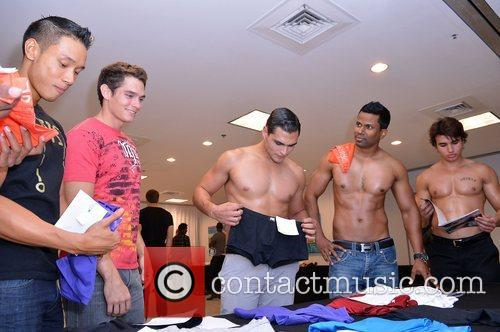 Models backstage during the 2012 SoBe Men's Show...