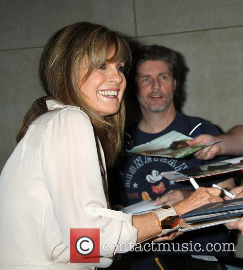 Linda Gray signs autographs as she leaves the...