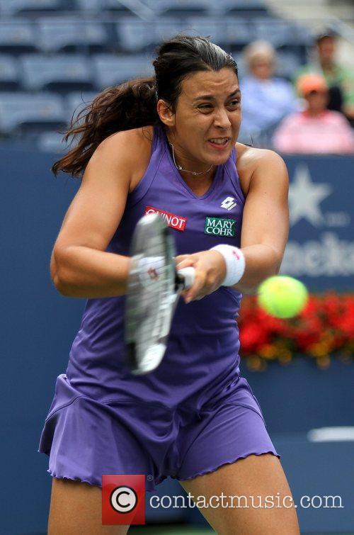 Marion Bartoli (FRA)  takes the lead in...