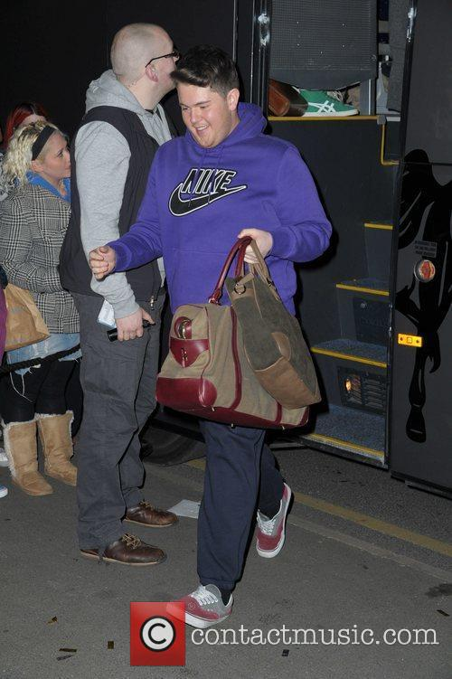 Craig Colton returns to his hotel after the...