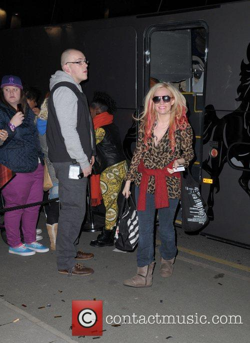 Kitty Brucknell returns to her hotel carrying a...