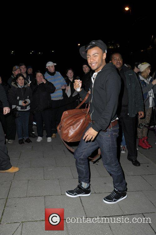 Marcus Collins returns to his hotel after the...