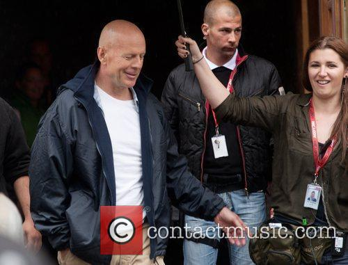Bruce Willis arriving on the film set to...