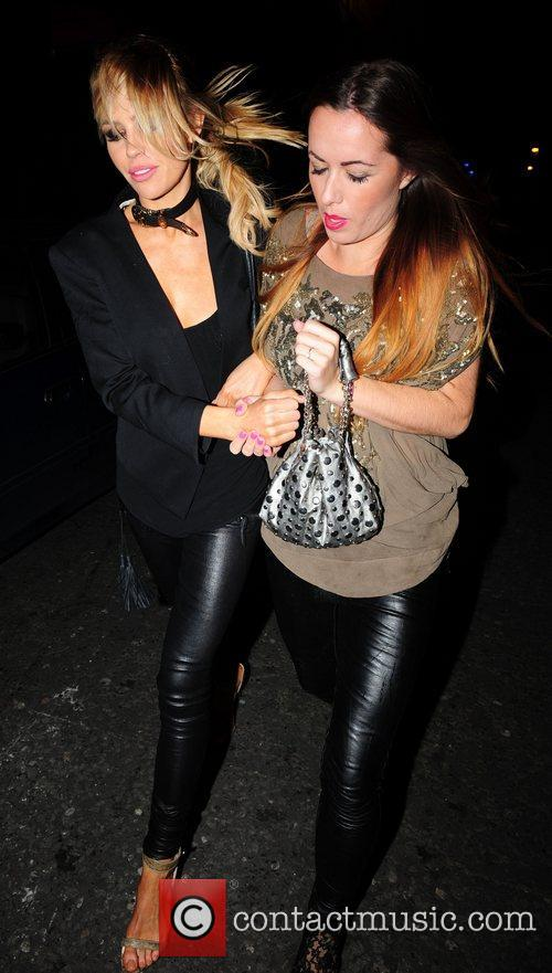 Abbey Clancy (left) out and about with a...