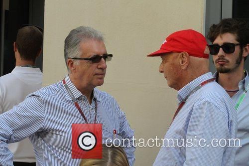 PIero FERRARI talking to Niki LAUDA  during...