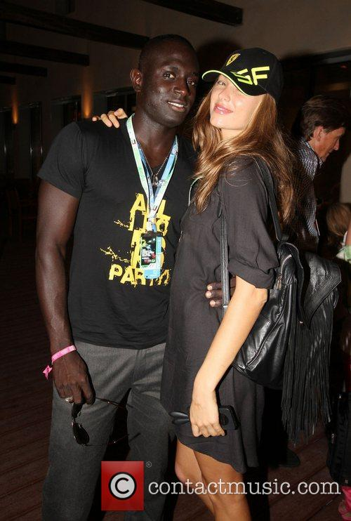 Ibou Thiam (L) with Model   during...