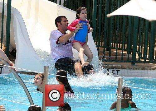 adam sandler slides into a pool with 5818714