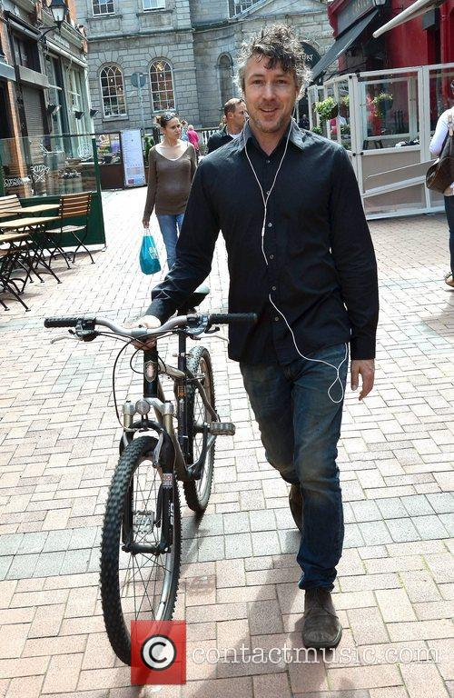 Actor Aidan Gillen spotted walking with his bike...