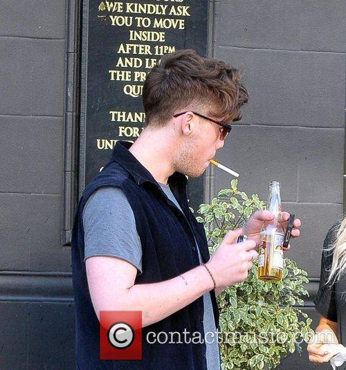 Smoking a cigarette outside a pub in north...
