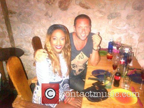 Poses for a fan photograph while dining in...