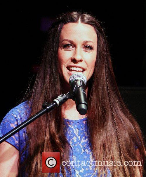 Alanis Morissette is honoured with handprints on Guitar...
