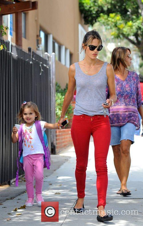 Picks up her daughter Anja from school in...