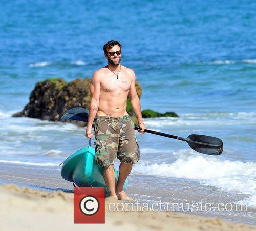 Jamie Mazur on Malibu beach with a sea...