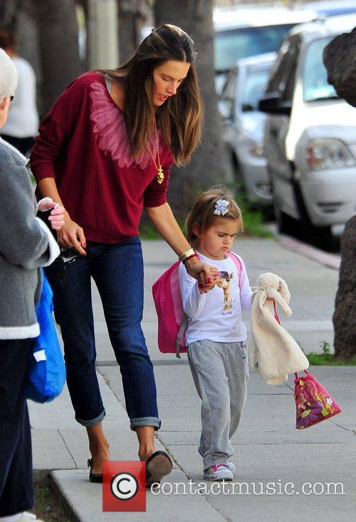 Alessandra Ambrosio holds her daughter Anja's hand whilst...