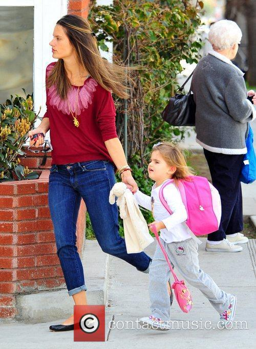 Holds her daughter Anja's hand whilst out in...