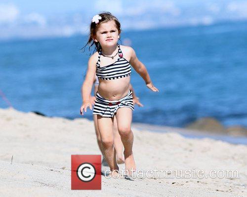 Alessandra Ambrosio spends the day on Malibu beach...