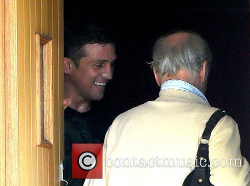 Alex Reid answers the door to his parents...