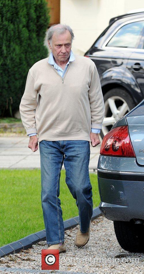 Alex Reid's father Bob arrives at his house...