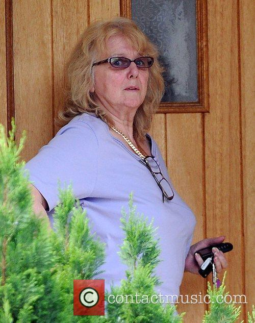 Alex Reid's mother Carol arrives at his house...