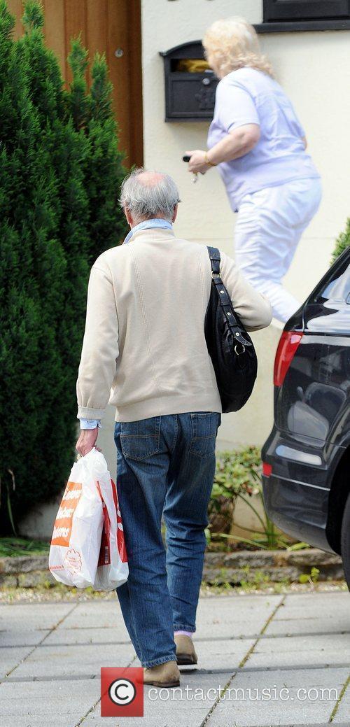 Alex Reid's parents Carol and Bob arrive at...