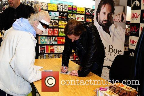 Signs copies of his new album 'Storyteller' at...
