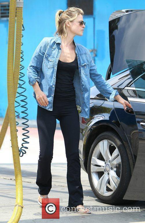 Ali Larter takes her car to the car...