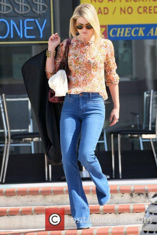 Leaves a clothing tailor in Beverly Hills carrying...
