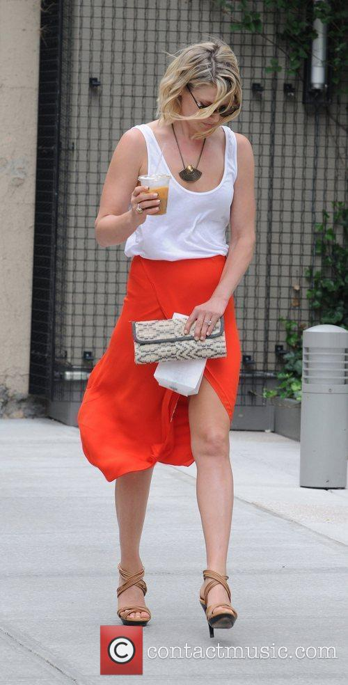 Takes a stroll through SoHo wearing an orange...