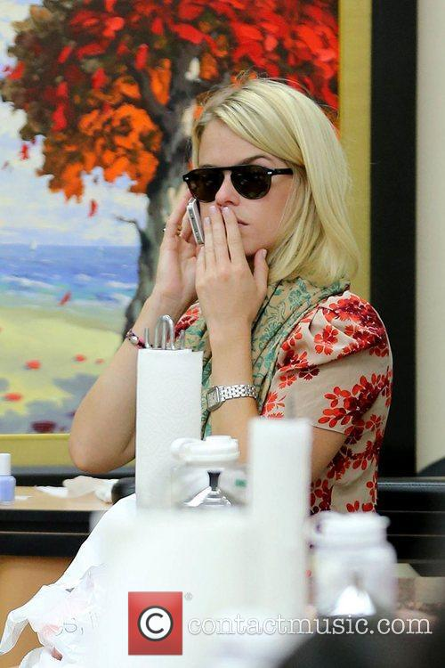 Visits Beverly Hills Nail Design for a manicure...