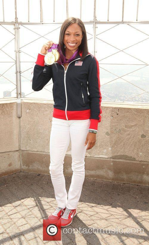 Triple Olympic gold medalist Allyson Felix poses with...