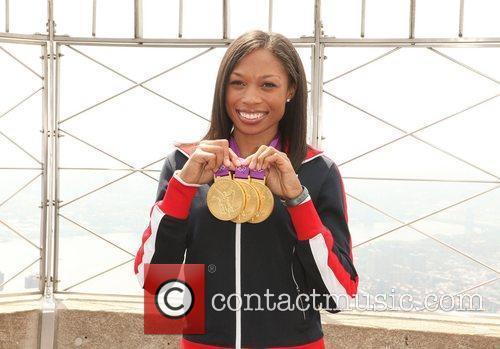 Poses with her medals during a photoshoot at...