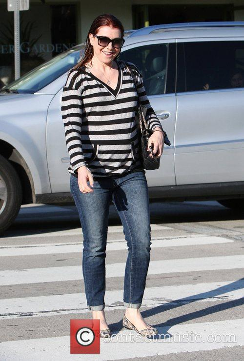 Leaves a hair salon in West Hollywood with...
