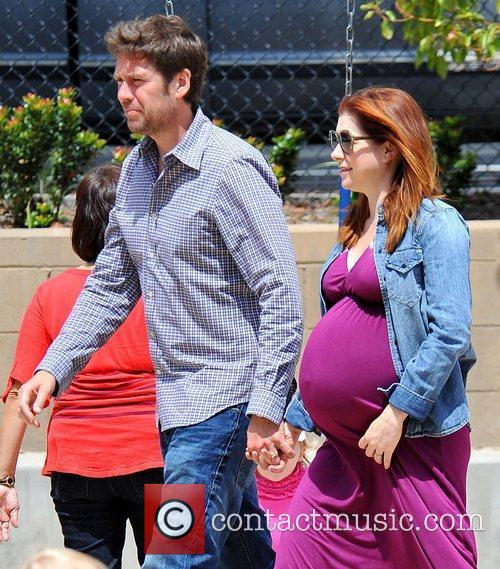 At the park with husband Alexis Denisof and...