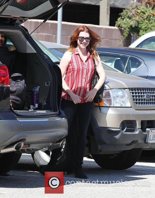 Alyson Hannigan collecting her daughter from school in...