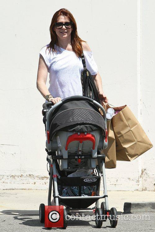 Alyson Hannigan has her hands full as she...