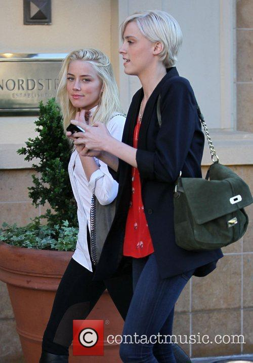 Amber Heard and her sister Whitney Heard are...