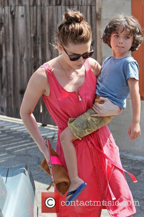 Seen leaving Decades Two on Melrose Avenue carrying...